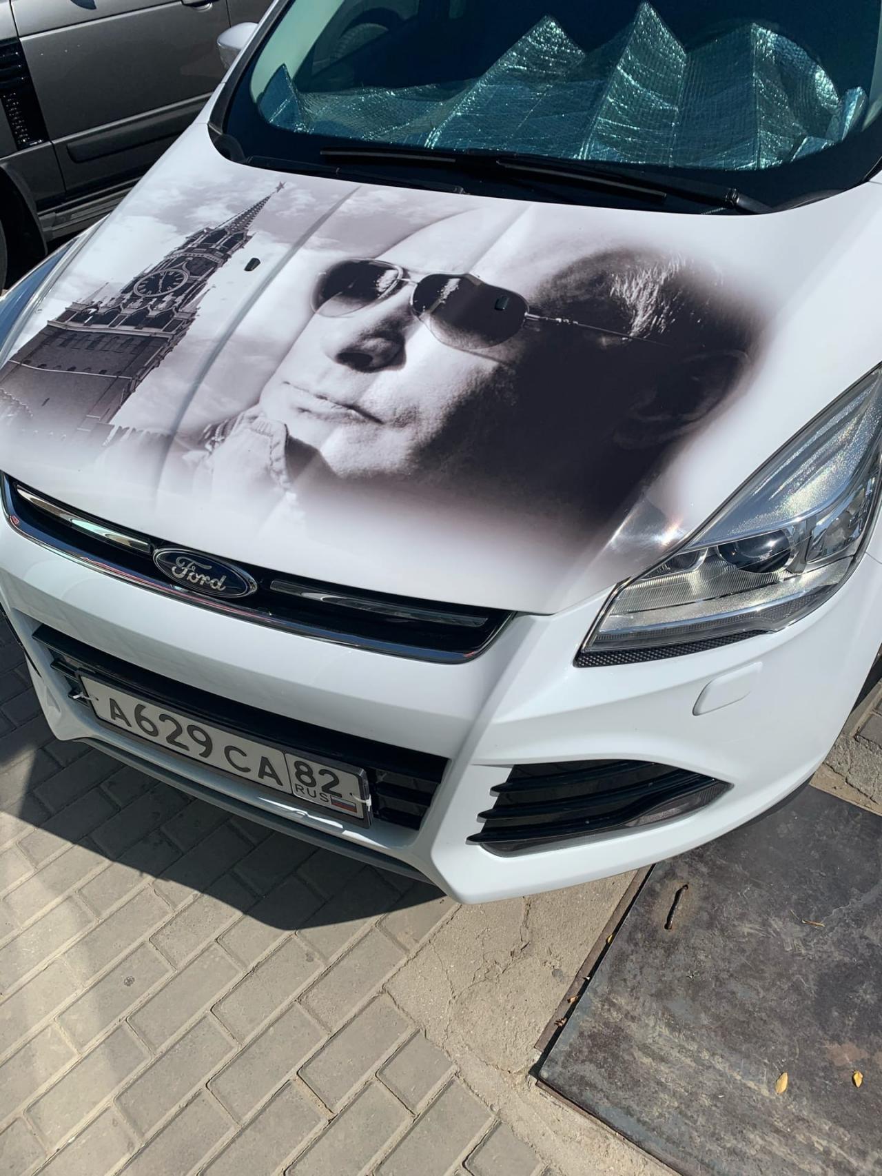 Как реагируют сотрудники ДПС на Путинмобиль